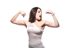 Girl showing muscles. Brunette girl showing her muscles Royalty Free Stock Images