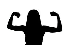 Girl showing muscles silhouette Stock Photos