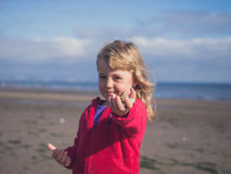 Girl showing mussels Royalty Free Stock Photo
