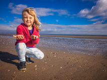 Girl showing mussels Stock Images