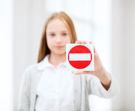 Girl showing no entry sign. Education, school and anti-bullying concept - student girl showing no entry sign Royalty Free Stock Photo