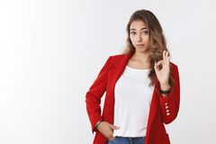 Girl showing not bad gesture. Impressed female colleague making ok okay sign looking respectful checking out awesome stock image