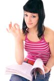 Girl showing ok sign. After reading a lesson Stock Photos