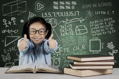 Girl showing ok sign with books and scribble Stock Image