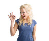Girl showing OK sign. With her hand Royalty Free Stock Image
