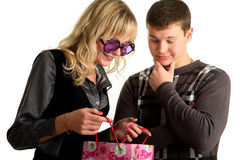 The girl is showing package shopping to her boyfri Royalty Free Stock Photo