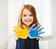 Girl showing painted hands Royalty Free Stock Photography