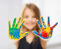Girl showing painted hands Stock Image
