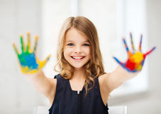 Girl showing painted hands Stock Images