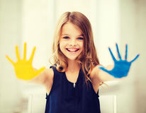 Girl showing painted hands Stock Photography