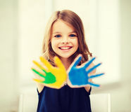 Girl showing painted hands Royalty Free Stock Image