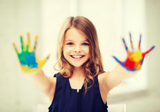 Girl showing painted hands. Education, school, art and painitng concept - little student girl showing painted hands at school stock photos