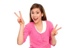 Girl showing peace sign. Young woman over white background Stock Photo