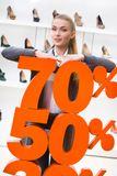 Girl showing the percentage of sales on footwear Stock Photo