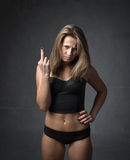 Girl showing rude gestures Royalty Free Stock Photos