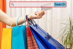 Girl showing shopping bags with search bar. Concept of on line s Stock Photo