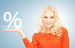 Girl showing sign of percent in her hand Royalty Free Stock Image