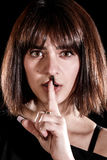 Girl showing the silence sign Royalty Free Stock Photos