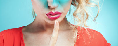 Girl showing silent sign. Royalty Free Stock Photo