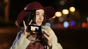 Girl showing smartphone with offer on screen stock video footage
