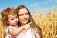 Girl showing something to her mother Stock Photography