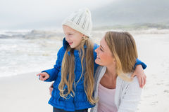 Girl showing something to mother at beach Royalty Free Stock Images