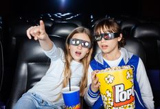 Girl Showing Something To Sister At 3D Theater Royalty Free Stock Photo