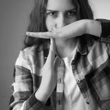 Girl showing stop hand sign gesture (Body language, gestures, ps Royalty Free Stock Image