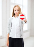 Girl showing stop sign Stock Image