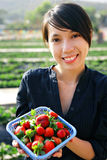 Girl showing strawberry Stock Image