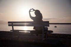 Girl showing sunrise. Royalty Free Stock Photo