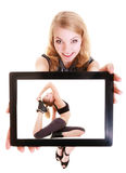 Girl showing tablet with fitness fit woman. Sport. royalty free stock images