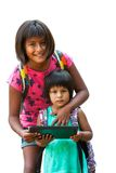 Girl showing tablet to youngster. Stock Photo