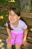 Girl showing teeth Royalty Free Stock Images