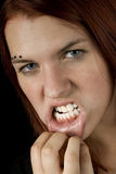 Girl showing teeth. And looking aggresive stock photo