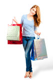 Girl showing their purchases in  studio Royalty Free Stock Photos