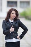 Girl showing thumb up Stock Photo