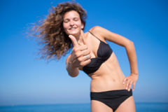 Girl showing thumb up Stock Image
