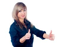 Girl showing thumb up gesture. Young beautiful woman showing thumb up gesture Stock Photo