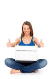 Girl showing thumbs up Royalty Free Stock Images