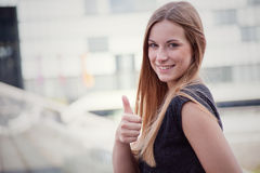 Girl showing thumbs up Royalty Free Stock Image