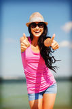 Girl showing thumbs up on the beach Royalty Free Stock Photography