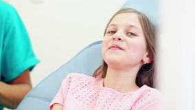Girl showing thumbs up at dentist stock video