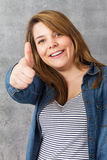 Girl showing thumbs up - okay Royalty Free Stock Photography