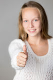 Girl showing thumbs up Royalty Free Stock Photos