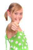 Girl showing thumbs up sign Royalty Free Stock Photography