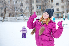 Girl showing thumbs up winter Stock Photos