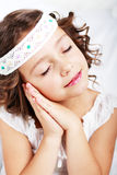Girl showing it is time to sleep Stock Photography