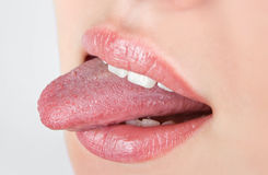 Girl showing tongue Royalty Free Stock Photography