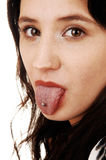 Girl showing tongue. Stock Images